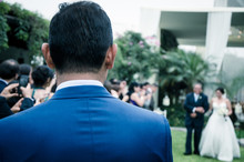 Outdoor Groom Is Waiting For Bride Who Is Coming With Her Dad In The Wedding
