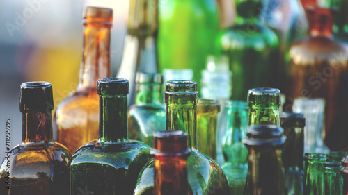 collection of old glass bottles, toned - 211995995