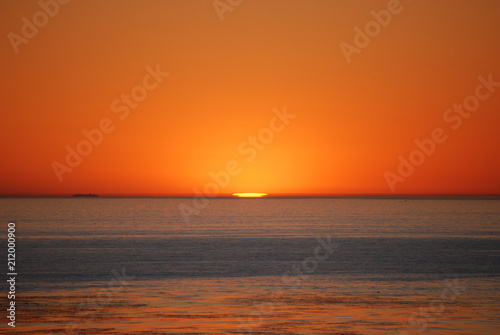 Spoed Foto op Canvas Zee zonsondergang gorgeous orange sunset in laguna beach california