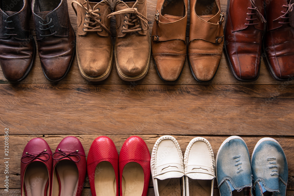 Fototapeta shoes with men and women various styles on a wooden floor - lifestyles.