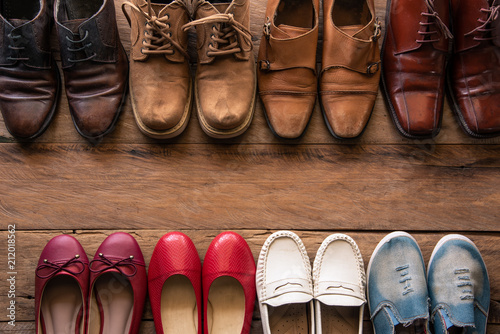 shoes with men and women various styles on a wooden floor - lifestyles Wallpaper Mural