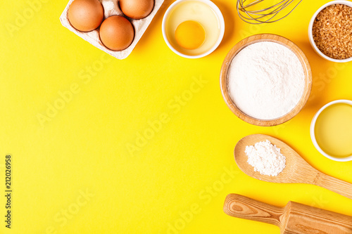 Fotografie, Obraz Ingredients and utensils for baking on a pastel background.