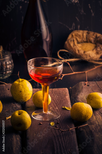 cup alcohol wooden table ingredients tincture quince