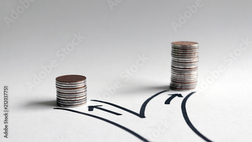 Fototapeta Two paths with different heights of coins. obraz