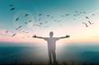 Leinwandbild Motiv Happy man rise hand on morning view. Christian inspire praise God on good friday background. Now one man self confidence on peak open arms enjoying nature the sun concept world wisdom fun hope.