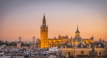 View Of La Giralda And Iglesia Del Salvador At Sunset, Bell Tower Of The Cathedral Of Seville, Catedral De Santa Maria De La Sede, Seville, Andalusia, Spain, Europe