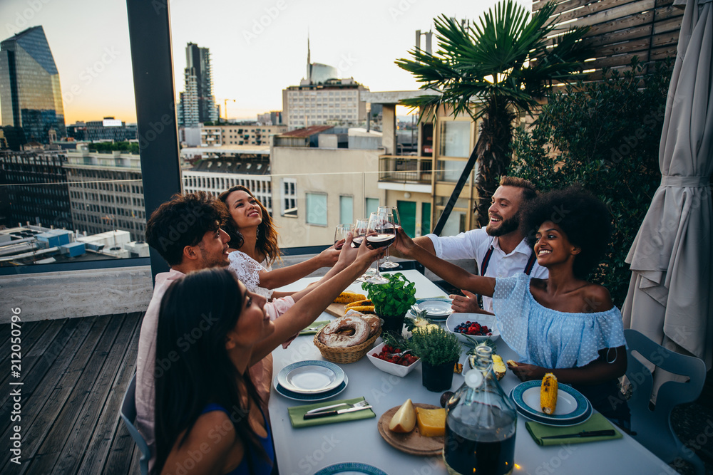 Fototapety, obrazy: Group of friends having fun on the rooftop of a beautiful penthouse
