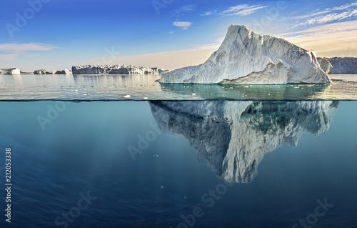 Valokuva  iceberg with above and underwater view