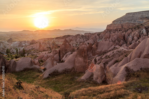 Tuinposter Beige Unreal landscape of Cappadocia. Colorful sunset in valley. G reme National Park of Turkey, background