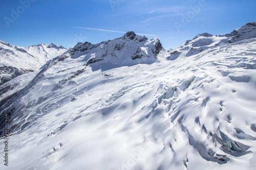 Foto op Aluminium Bergen Snow-covered glacier in a Mountains of Saas-Fee in Switzerland