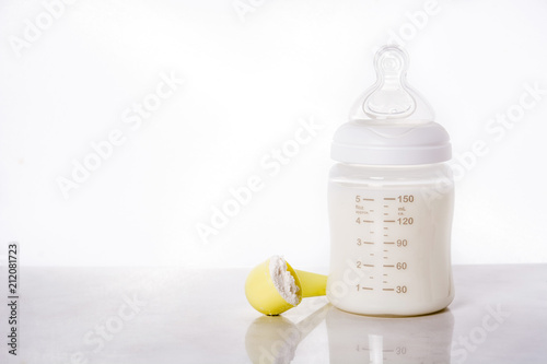 Baby bottle and milk on white background. Copyspace Tapéta, Fotótapéta