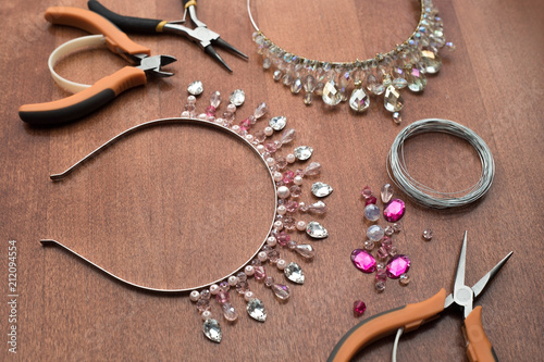 Fotografie, Obraz  The process of creating jewelry from wire and crystals