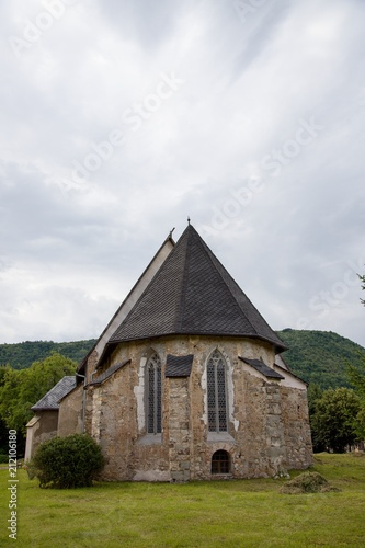 Tuinposter Monument Gothic church in Plesivec, Slovakia