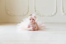 Baby Girl Wearing A Peach Tutu...
