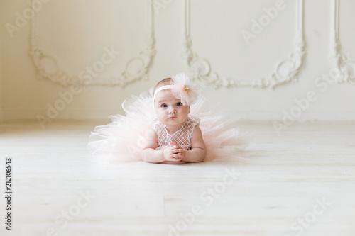 Fotografie, Obraz  Baby girl wearing a peach tutu
