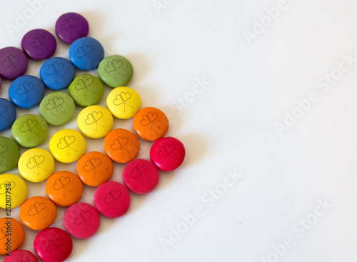 Fotografía  rainbow color chocolates with lesbian symbol drawn