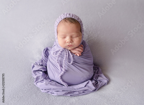 Fototapeta sleeping newborn baby girl