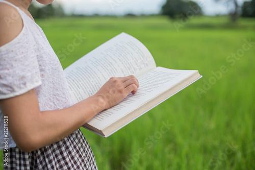 Deurstickers girl is reading a book