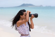 Woman Clicking Photo With Digi...