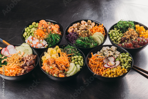 Bowls with assorted Asian food