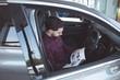 Salesman reading brochure inside the car