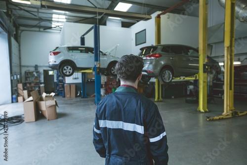 Mechanic standing in repair garage