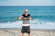 Senior man exercising on the beach