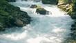 Rapid water spring running through mountainous canyon