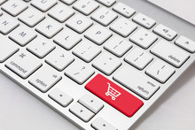 "White Keyboard With Red ""shopping Cart"" Symbol Key"
