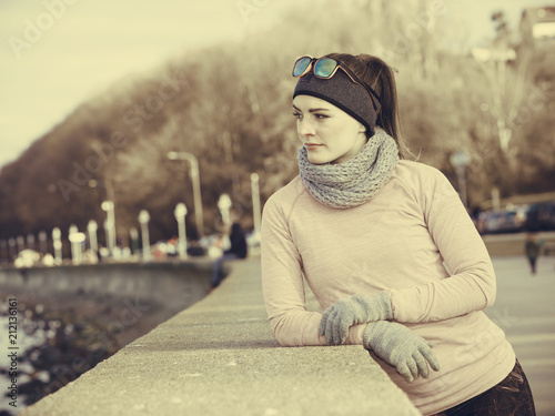 Staande foto Ontspanning Woman resting after doing sports outdoors on cold day