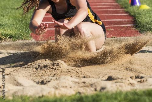 Fényképezés  Jumper landing in sand close up