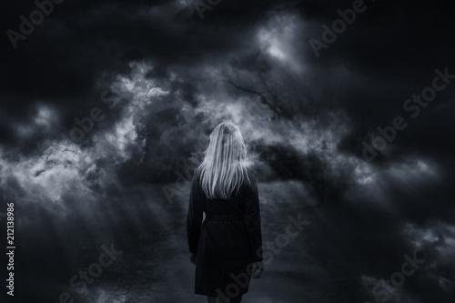 Photo  Dramatic dark stormy sky with woman walking