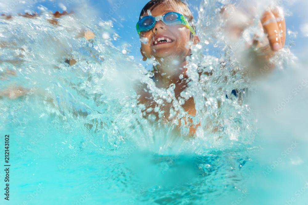 Fototapety, obrazy: Happy boy having fun splashing water in the pool