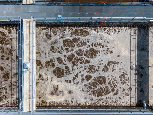 Fototapeta  Aerial view of wastewater treatment plant with water pools in Europe