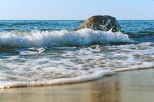 The Waves Break On The Coastal...