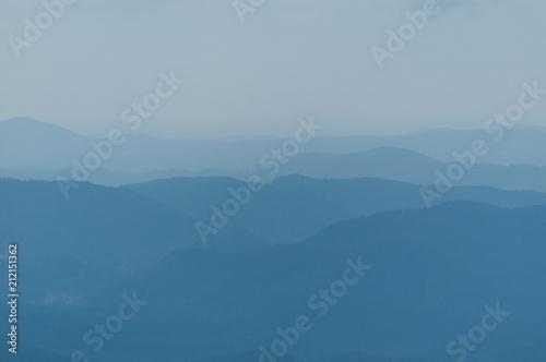 Fotografia, Obraz  A series of mountain ridges receding into the blue haze