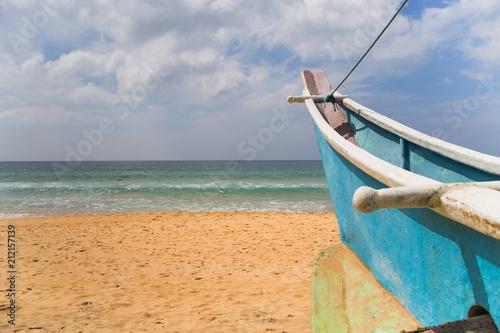 Staande foto Strand Image of boat at the beach in Sri Lanka.