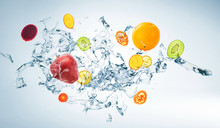 Water Splash With Various Fruits Isolated On White Background , Mixed Media .