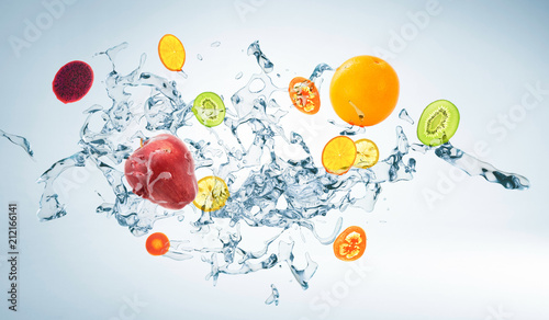 Foto op Canvas In het ijs Water splash with various fruits isolated on white background , mixed media .