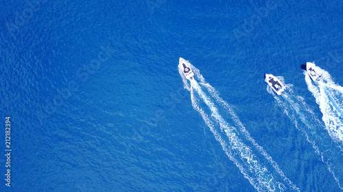 Fotografie, Obraz  Aerial birds eye view from drone of boats cruising in deep blue sea