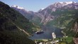 Geiranger fjord area, Norway. Aerial view at summer time. Fairytale landscape with its majestic, snow-covered mountain tops. Fantastic view of one of most beautiful tourist destinations in the world