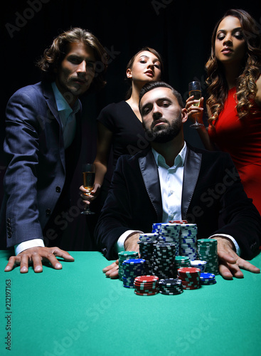 Poster  Attractive young caucasian man make bet in the casino
