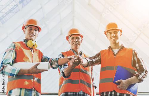 Standing Industrial Engineers in Vests and Helmets