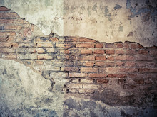 Old Crack Concrete Cement Wall With Red Brick Block Inside. Vintage Background Texture