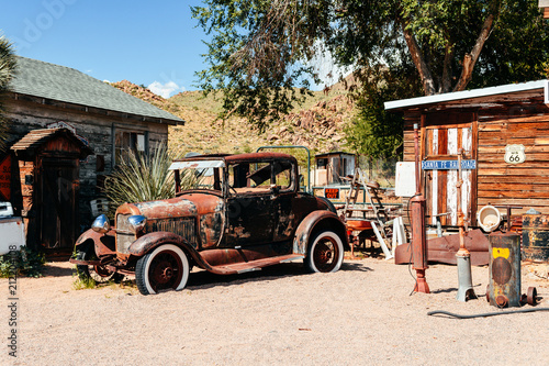 abandoned retro car in Route 66 gas station, Arizona, Usa Wallpaper Mural