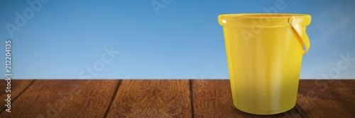 Composite image of new yellow bucket