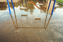 Empty Swings On Flooded Childr...