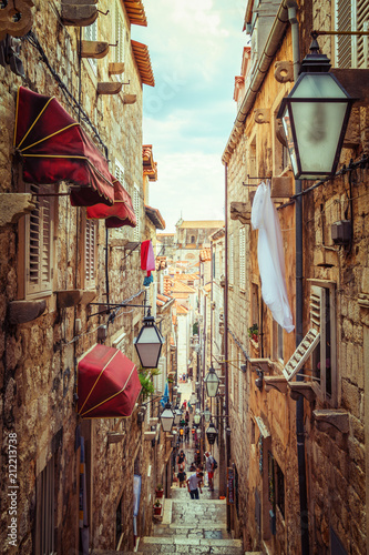 Photo Stands Narrow alley Famous narrow alley of Dubrovnik old town, Croatia