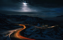 The Winding Mountain High Alpine Road Pass At Night With Light Tracks From Cars, Grossglockner Hochalpenstrasse, Austria