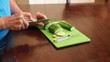 slicing fresh cucumbers